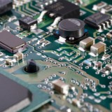 shallow depth-of-field image of green computer circuit board